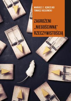 Zagrożeni niegościnną rzeczywistością-Jędrzejko Mariusz Z., Kozłowski Tomasz